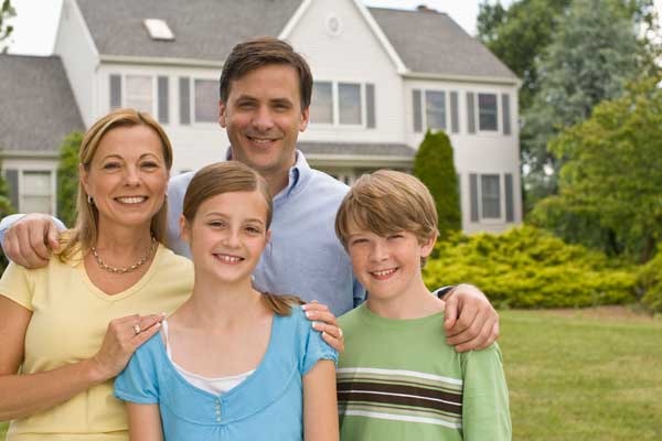 family-in-front-of-home
